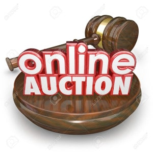 Online Auction 3d words on a wood block with a gavel closing the bidding on an item in an internet online website marketplace